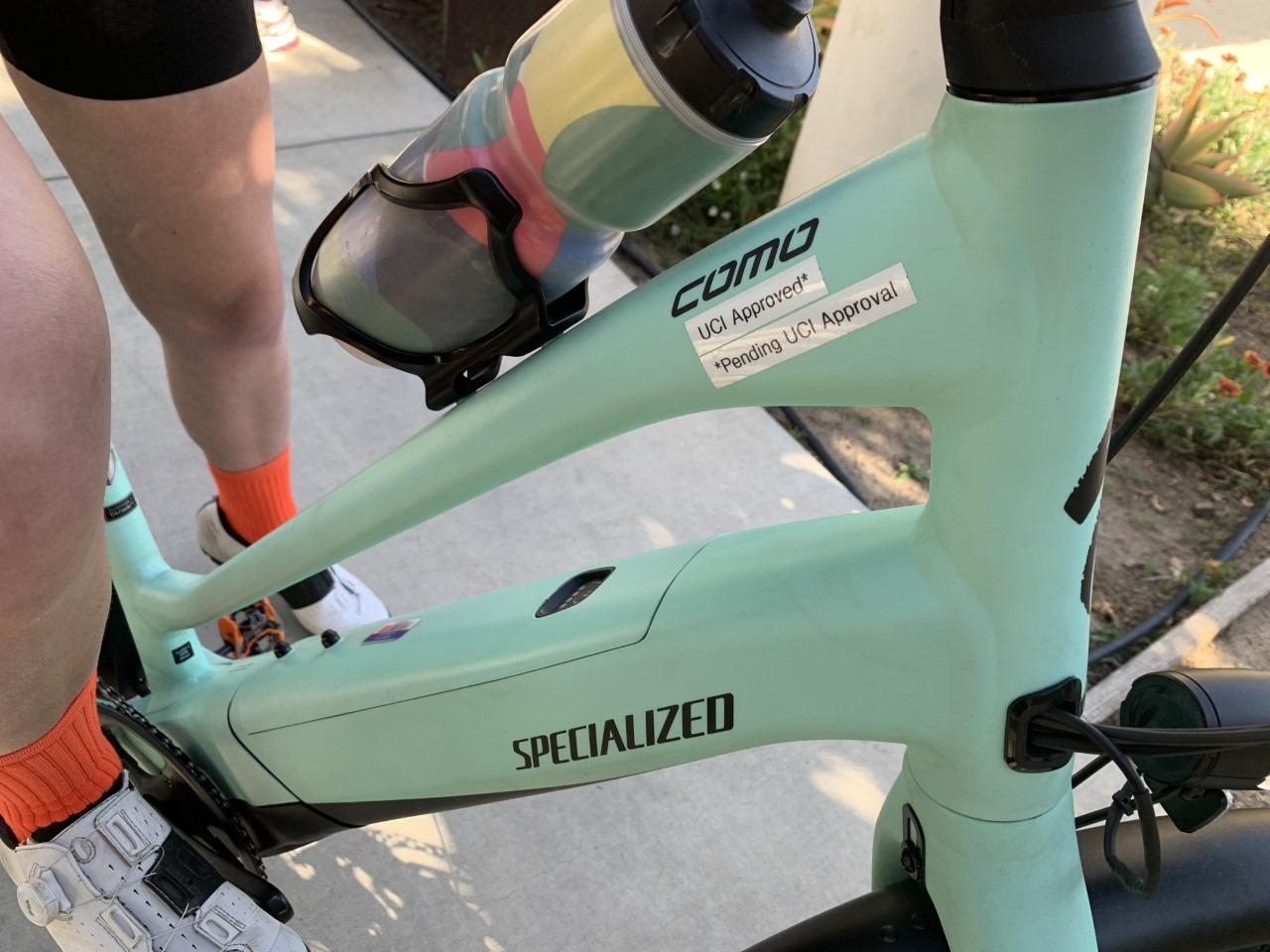 """Specialized Turbo Como with a label that reads """"UCI Approved* *Pending UCI Approval"""""""
