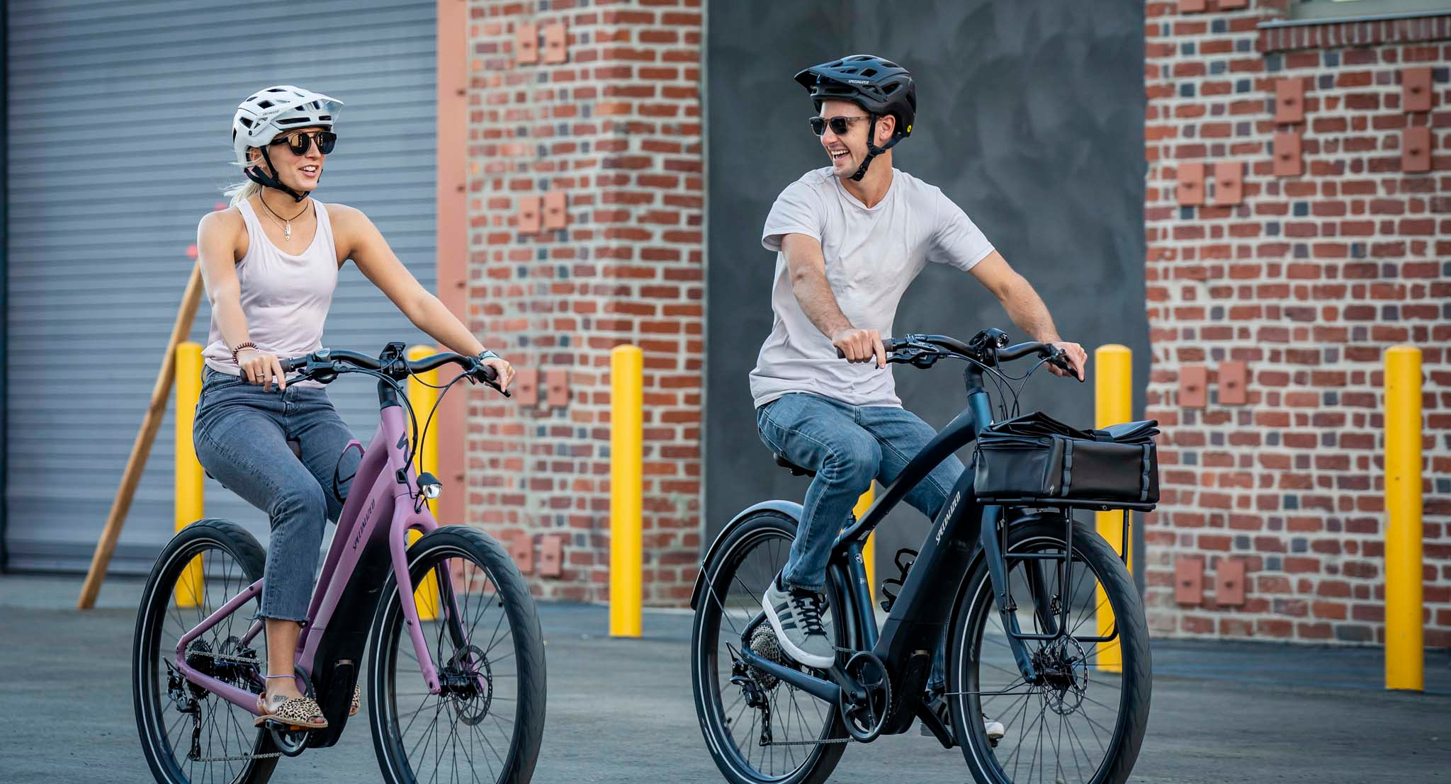couple riding specialized ebikes