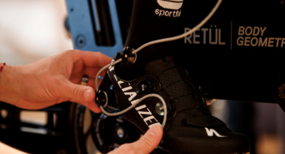 specialized guru fitter working on shoe