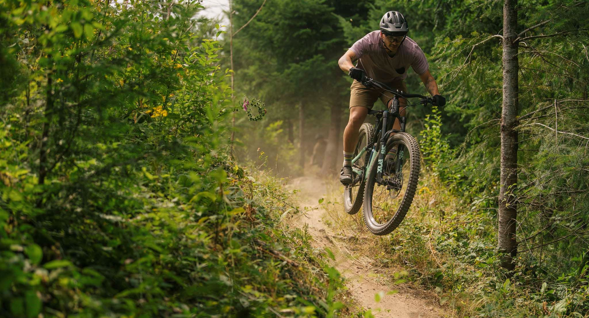 specialized mountain bike rider on trail