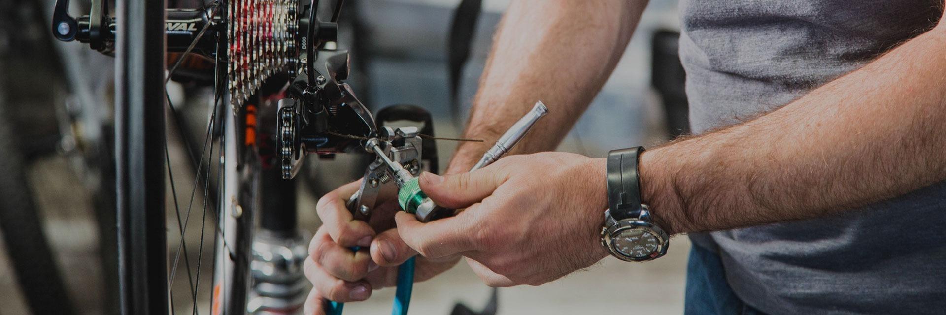 Bike Technician repairing a bike.