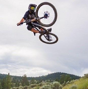 Tristan Klausat jumping on mountain bike