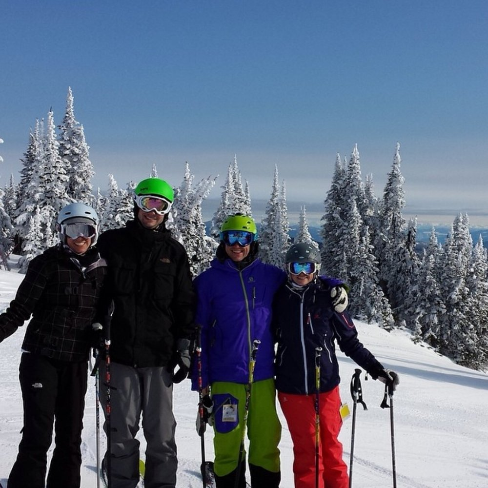Four Adults Skiing