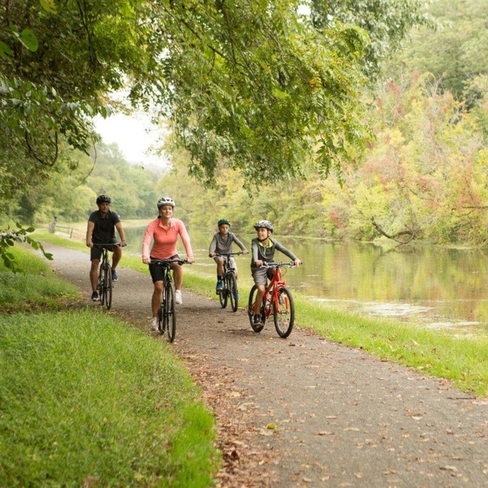 Family riding bikes on path