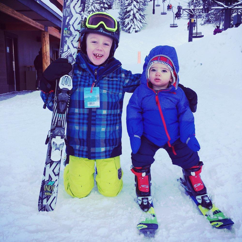 Two children skiing