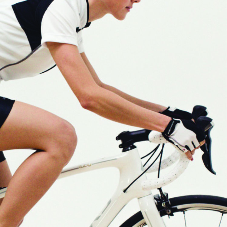 Person riding a white bicycle indoors