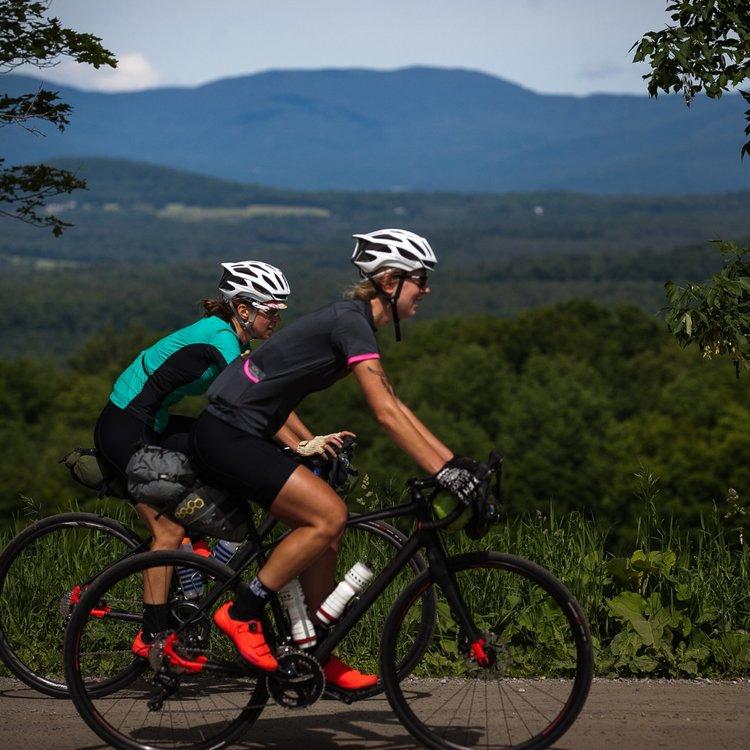 Two women riding road bikes