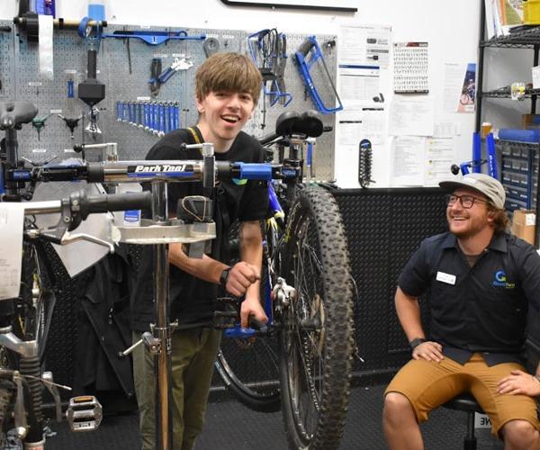 Two Bike Technicians working on a bike