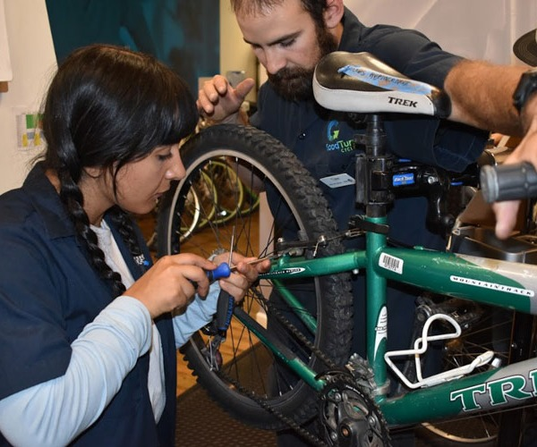 Bike Technician adjusting brakes