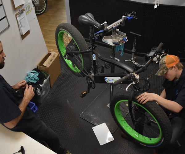 Bike Technician working on the front of a bike