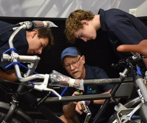 3 Bike Technicians working on a bike