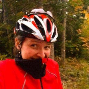 Jen Dodge outside wearing a helmet