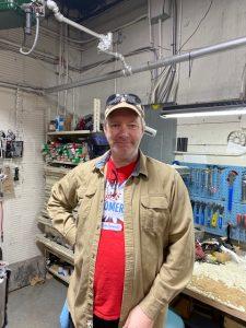 John Ryan standing inside bike shop