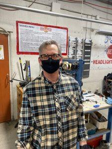 Thomas inside of bike shop wearing face mask