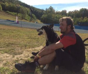 Travis Kelley Sitting outside with a dog