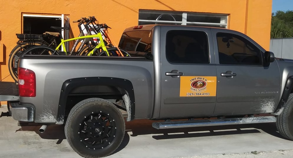 Infinity Bike Shop pick-up & delivery truck