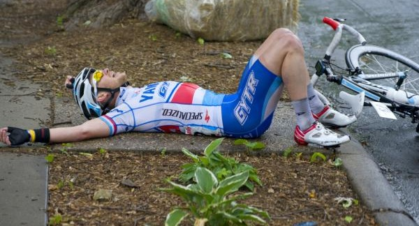 Road cyclists stretching on the ground.
