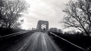 Cyclist entering suspernsion bridge