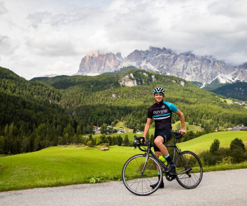 cyclist in front of a mountain range
