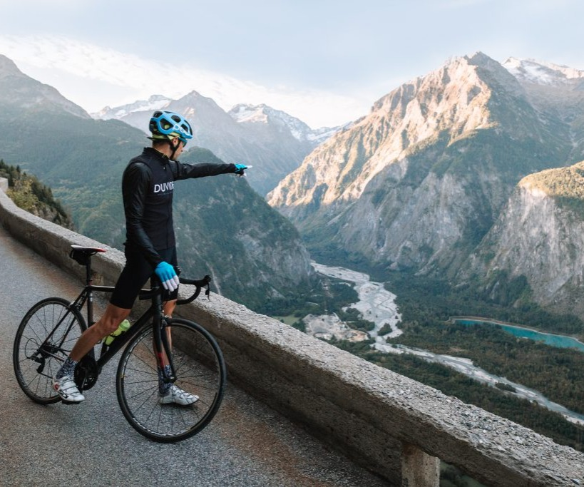 road cyclist looking into a river valley