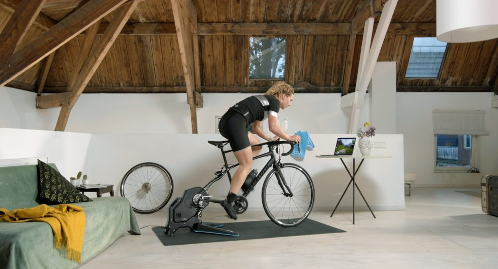 cyclist on a smart trainer with a training video