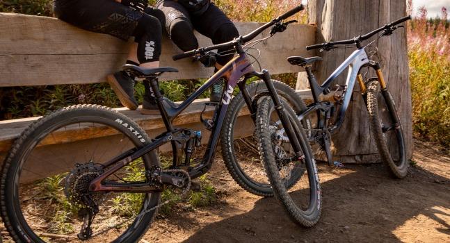 Mountain bikes leaned against fence