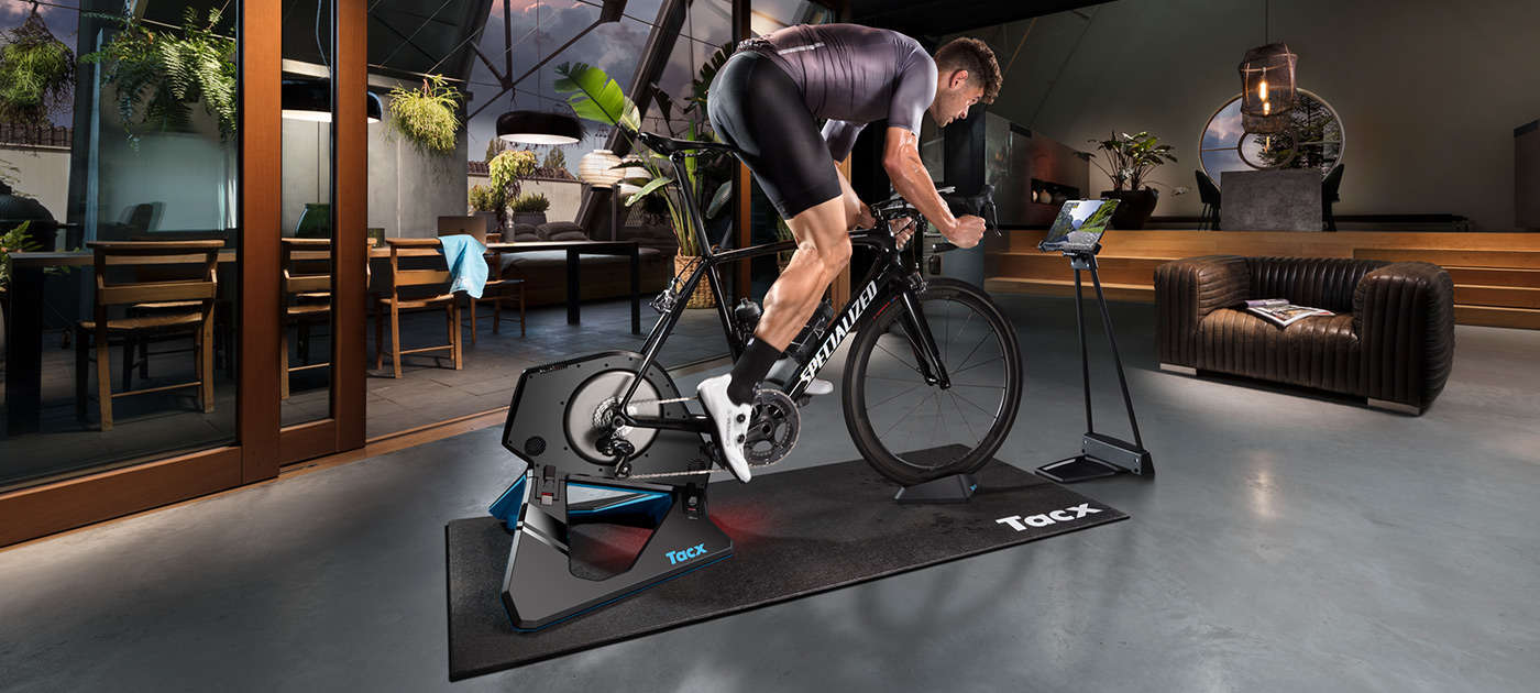 A person riding on a Tacx trainer in their home