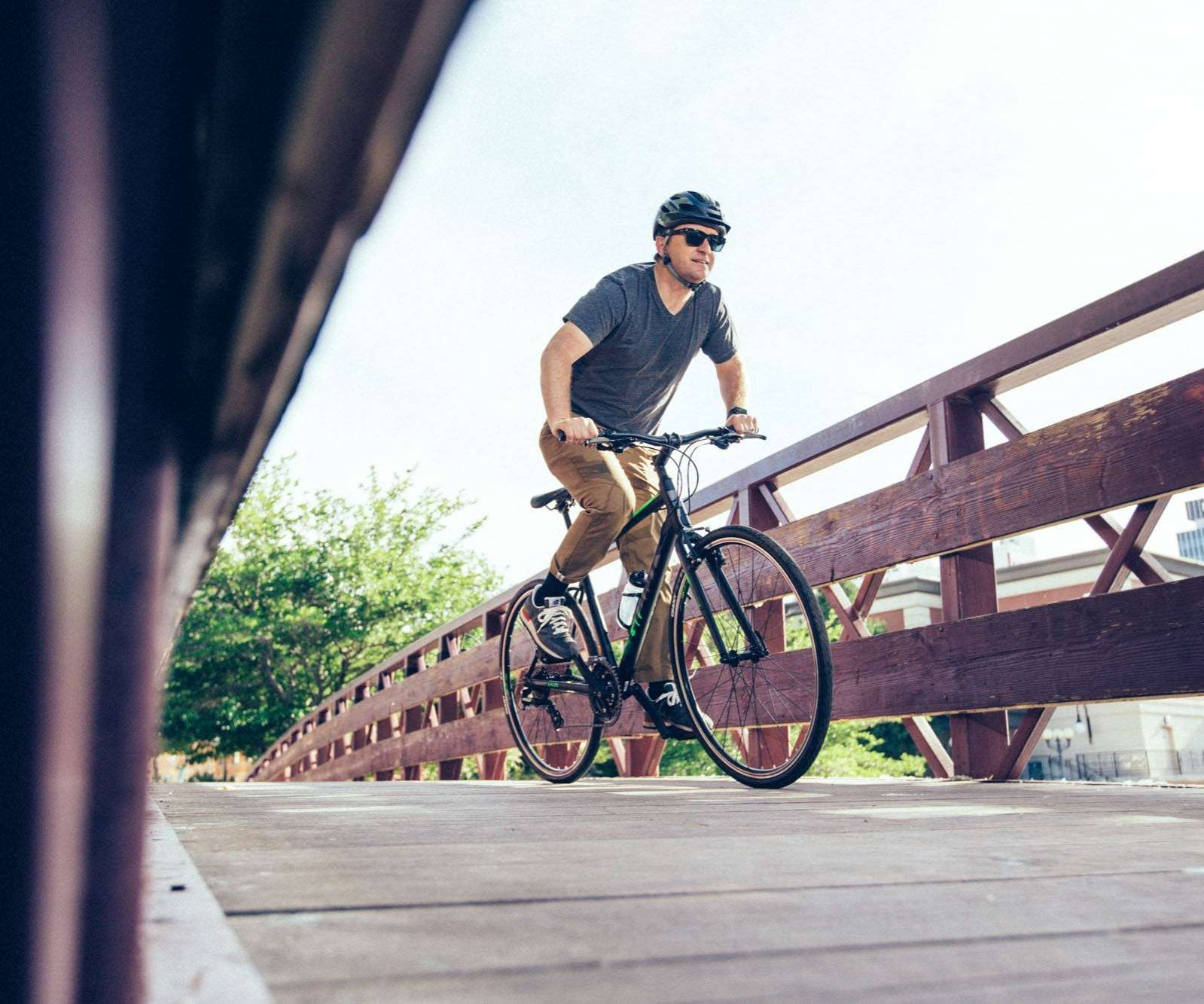 Person commuting on a bike over a bridge