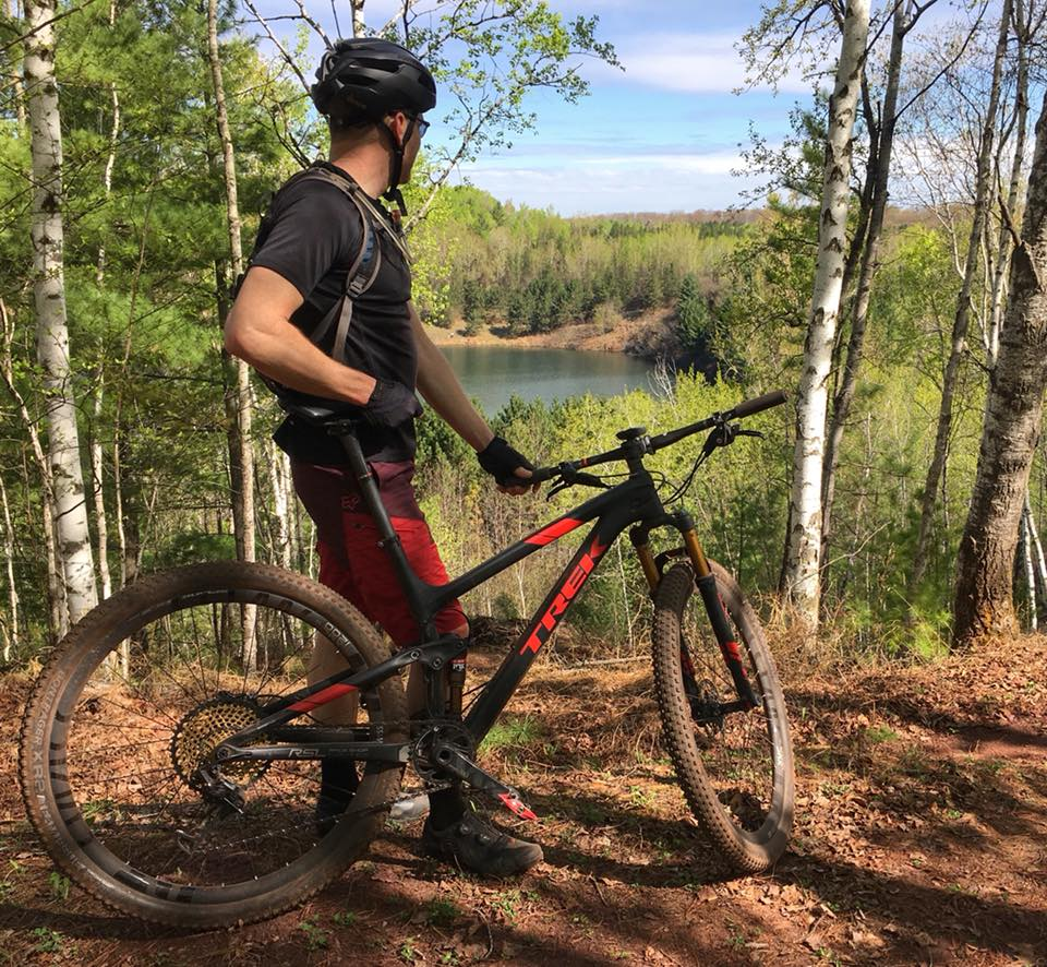 mountain biker looking out on lake