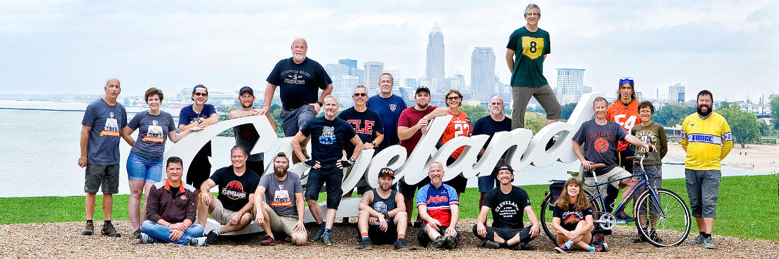 The Century Cycles team at the Cleveland script sign at Edgewater Park
