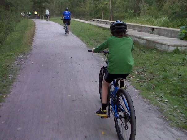 Family riding on the Towpath Trail
