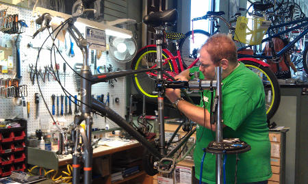 One of Century Cycles' expert mechanics assembles a new bicycle
