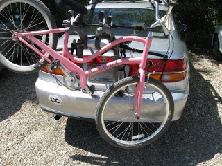 Bicycle on car rack with wheel too close to the ground