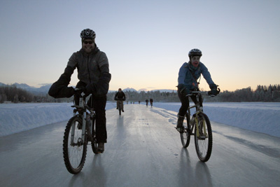 Bicyclists on icy trail