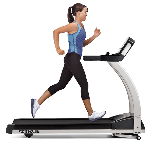 Woman running on True treadmill