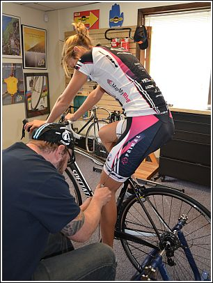 Lane fitting professional cyclist, Kasey Clark.
